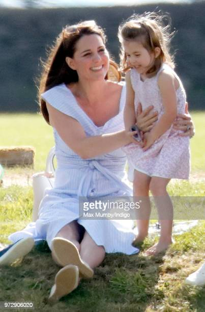 Catherine Duchess of Cambridge and Princess Charlotte of Cambridge attend the Maserati Royal Charity Polo Trophy at the Beaufort Polo Club on June 10...