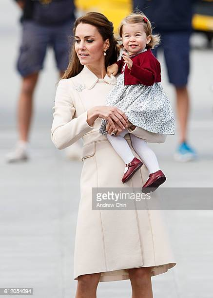 Catherine Duchess of Cambridge and Princess Charlotte wave as they leave from Victoria Harbour to board a seaplane on the final day of their Royal...