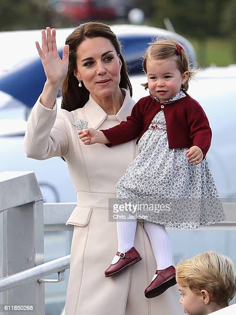 Catherine, Duchess of Cambridge and Princess Charlotte wave leave from Victoria Harbour to board a sea-plane on the final day of their Royal Tour of...