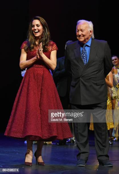 Catherine Duchess of Cambridge and producer Michael Linnet take part in a presentation during the Opening Night Royal Gala performance of 42nd Street...