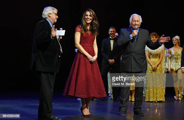 Catherine Duchess of Cambridge and producers Michael Linnet and Michael Grade speak during the Opening Night Royal Gala performance of 42nd Street in...