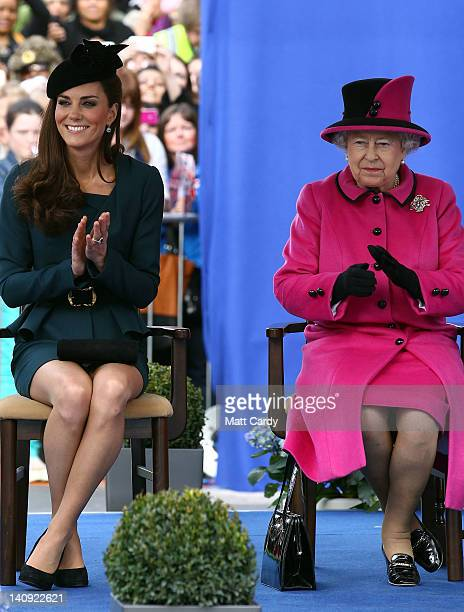 Catherine Duchess of Cambridge and Queen Elizabeth II applaud as they listen to a welcome speech in Leicester city centre on March 8 2012 in...