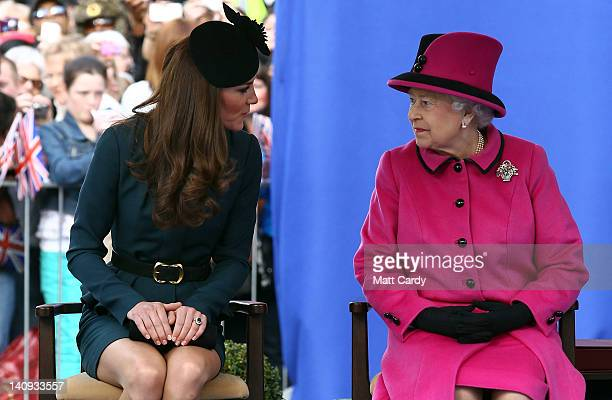 Catherine Duchess of Cambridge and Queen Elizabeth II chat as they listen to a welcome speech in Leicester city centre on March 8 2012 in Leicester...