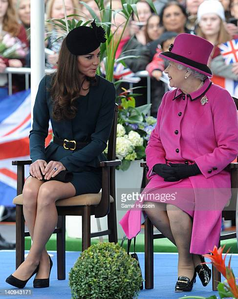 Catherine Duchess of Cambridge and Queen Elizabeth II during their visit to Leicester on March 8 2012 in Leicester England The royal visit to...