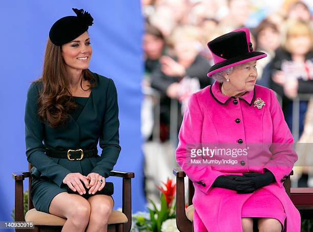 Catherine Duchess of Cambridge and Queen Elizabeth II listen to a speech as they and Prince Philip Duke of Edinburgh visit Leicester on the first...