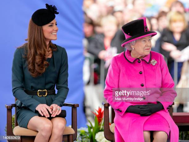 Catherine, Duchess of Cambridge and Queen Elizabeth II listen to a speech as they and Prince Philip, Duke of Edinburgh visit Leicester on the first...