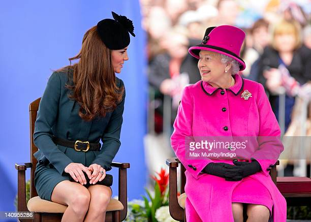Catherine Duchess of Cambridge and Queen Elizabeth II listen to a speech as they accompanied by Prince Philip Duke of Edinburgh visit Leicester on...