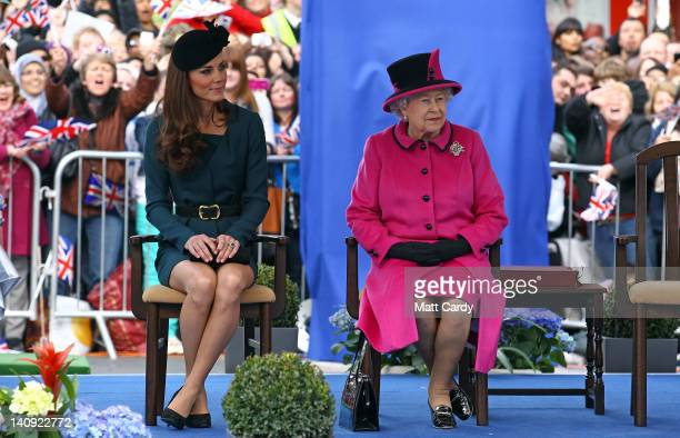 Catherine, Duchess of Cambridge and Queen Elizabeth II listen to a welcome speech in Leicester city centre on March 8, 2012 in Leicester, England....