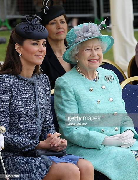 Catherine Duchess of Cambridge and Queen Elizabeth II smile as they visit Vernon Park during a Diamond Jubilee visit to Nottingham on June 13 2012 in...