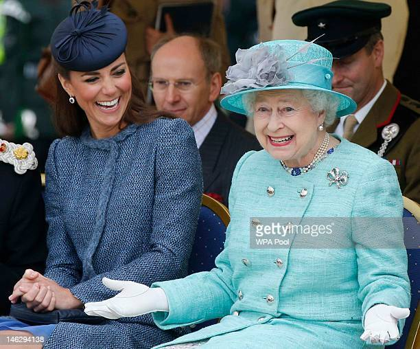 Catherine, Duchess of Cambridge and Queen Elizabeth II watch part of a children's sports event while visiting Vernon Park during a Diamond Jubilee...