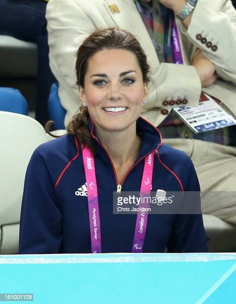 Catherine Duchess of Cambridge and Rebecca Deacon sit amongst members of the public to watch the swimming on day 1 of the London 2012 Paralympic...