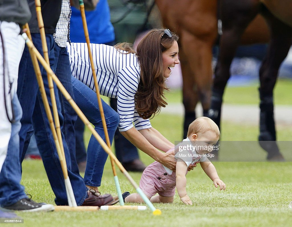 Catherine, Duchess of Cambridge and son Prince George of Cambridge watch Prince William, Duke of Cambridge & Prince Harry play in the Jerudong Trophy charity polo match at Cirencester Park Polo Club on June 15, 2014 in Cirencester, England.