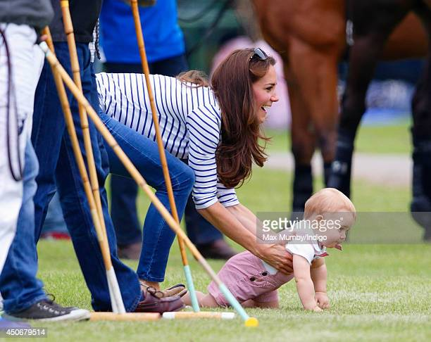 Catherine Duchess of Cambridge and son Prince George of Cambridge watch Prince William Duke of Cambridge Prince Harry play in the Jerudong Trophy...