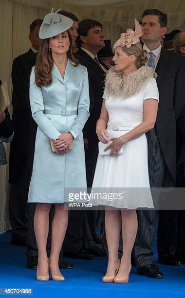 Catherine Duchess of Cambridge and Sophie Countess of Wessex watch as Queen Elizabeth II leads the Knights of the Garter to the Most Noble Order of...