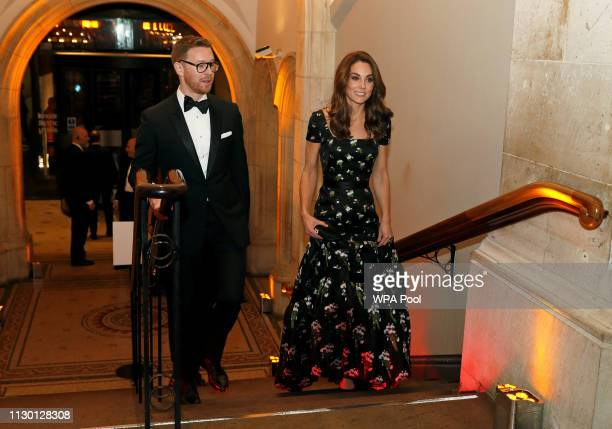 Catherine, Duchess of Cambridge and speaks with Dr Nicholas Cullinan, Director of National Portrait Gallery attend the 2019 Portrait Gala at the...