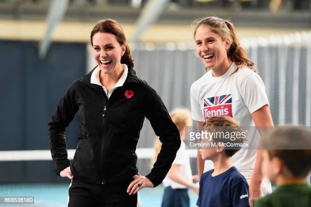 Catherine Duchess of Cambridge and tennis player Johanna Konta play tennis with children as they visit the Lawn Tennis Association at National Tennis...