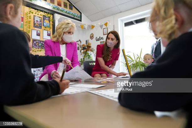 Catherine, Duchess of Cambridge and U.S. First Lady Dr Jill Biden, looking at a picture of the cover of Greta and the Giants, in the schools...
