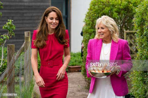 Catherine, Duchess of Cambridge and U.S. First Lady Dr Jill Biden, carrying carrots for the school rabbit, Storm, during a visit to Connor Downs...