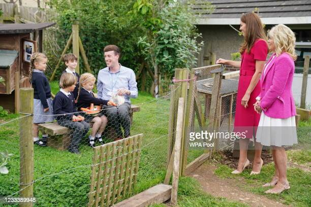 Catherine, Duchess of Cambridge and U.S. First Lady Dr Jill Biden speak with the schools Reception Class and meet the school rabbit Storm, during a...