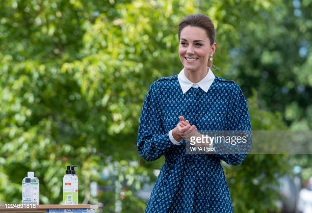 Catherine, Duchess of Cambridge applies hand sanitizer during a visit to Queen Elizabeth Hospital in King's Lynn as part of the NHS birthday...