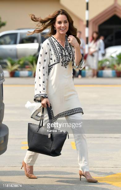 Catherine Duchess of Cambridge arrives at Lahore airport with Prince William Duke of Cambridge to take their flight back to Islamabad during their...