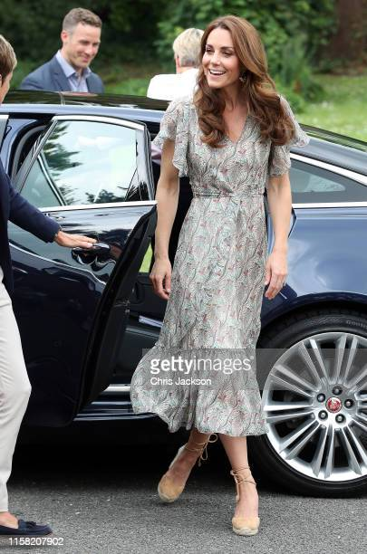 Catherine Duchess of Cambridge arrives for a photography workshop for Action for Children run by the Royal Photographic Society at Warren Park on...