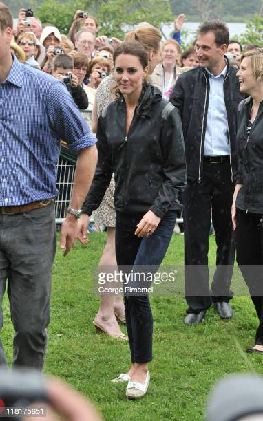 Catherine Duchess of Cambridge arrives on shore after rowing dragon boats across Dalvay lake on July 4 2011 in Charlottetown Canada