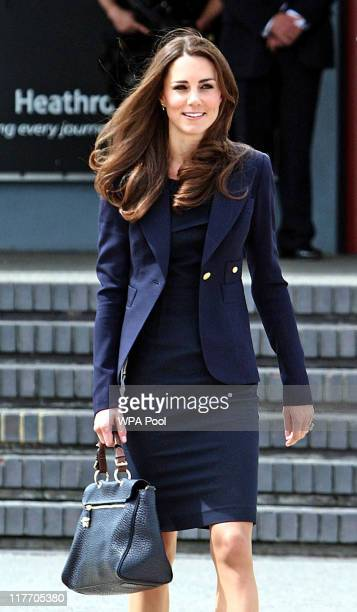 Catherine Duchess of Cambridge arrives to board a plane of the Royal Canadian Air Force at London's Heathrow Airport on June 30 2011 in London...