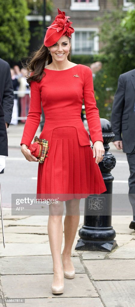 Catherine, Duchess of Cambridge, arrives to board the royal barge 'Spirit of Chartwell' during the Thames Diamond Jubilee Pageant on the River Thames in London on June 3, 2012. Queen Elizabeth II was to sail on a ceremonial barge down the Thames on Sunday at the centre of a 1,000-boat pageant to mark her diamond jubilee, although heavy rain threatened to spoil the party.