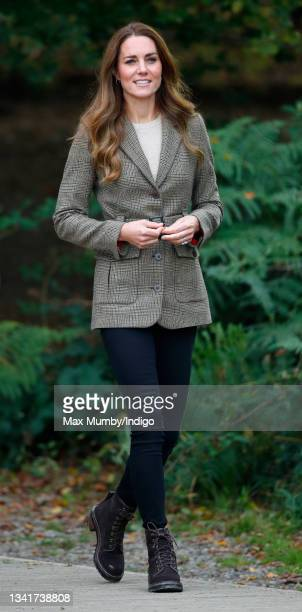 Catherine, Duchess of Cambridge arrives to embark on a boat trip, on Lake Windermere, with two of the 'Windermere Children', a group of 300 child...