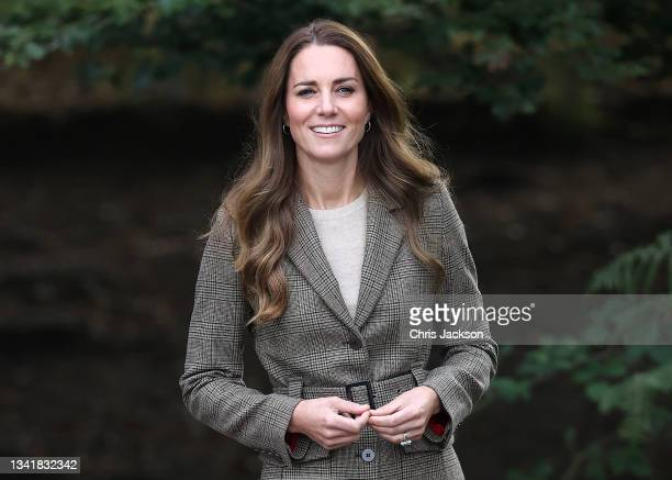 """Catherine, Duchess of Cambridge arrives to embark on a boat trip on Lake Windermere with two of the """"Windermere Children"""", a group of 300 child..."""