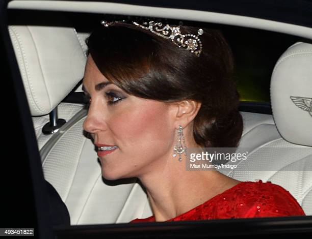 Catherine Duchess of Cambridge arrives wearing a tiara made by Garrard London at Buckingham Palace to attend a State Banquet to honour the State...