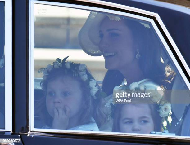 Catherine Duchess of Cambridge arrives with Florence van Cutsem and Princess Charlotte at St George's Chapel at Windsor Castle for the wedding of...