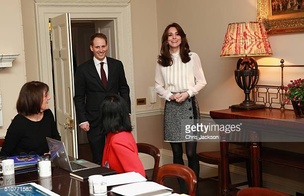 Catherine Duchess of Cambridge arrives with Steven Hull in the 'News Room' at Kensington Palace on February 17 2016 in London England The Duchess of...