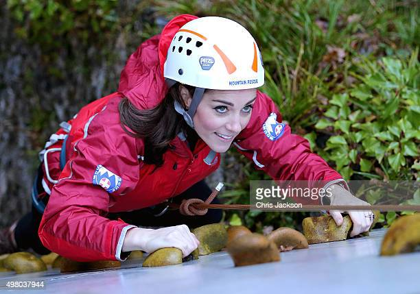 Catherine Duchess of Cambridge ascends a climbing wall as she visits the Towers Residential Outdoor Education Centre on November 20 2015 in Capel...
