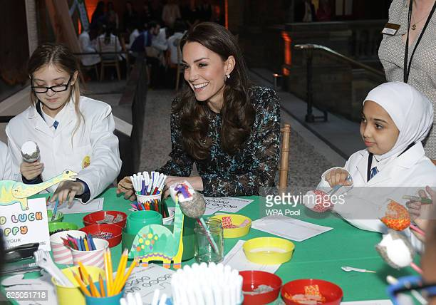 Catherine Duchess of Cambridge attends a children's tea party with pupils from Oakington Manor Primary School in Wembley at the Natural History...