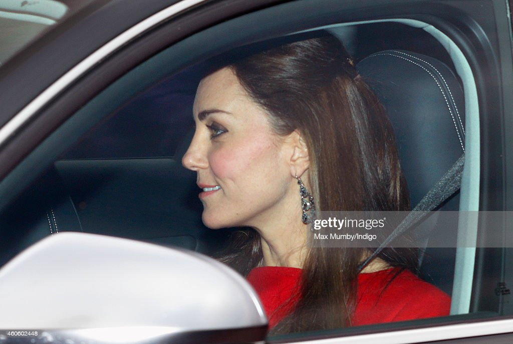 Catherine, Duchess of Cambridge attends a Christmas lunch for members of the Royal Family hosted by Queen Elizabeth II at Buckingham Palace on December 17, 2014 in London, England.