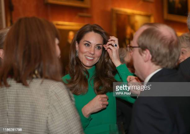 Catherine Duchess of Cambridge attends a reception for NATO leaders hosted by Queen Elizabeth II at Buckingham Palace on December 3 2019 in London...