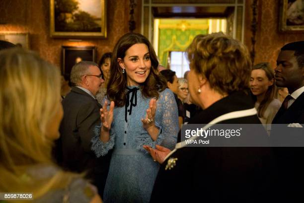 Catherine Duchess of Cambridge attends a reception on World Mental Health Day to celebrate the contribution of those working in the mental health...