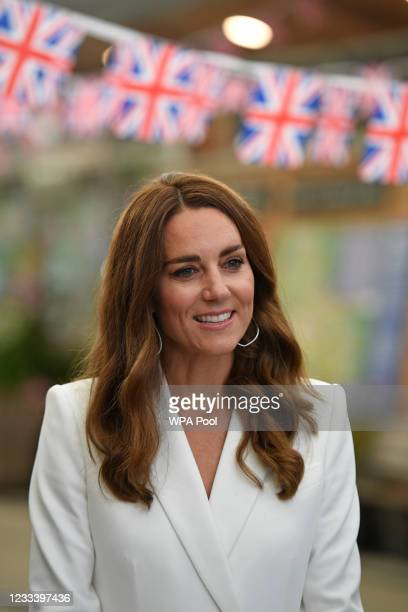 Catherine, Duchess of Cambridge attends an event with Queen Elizabeth II in celebration of The Big Lunch initiative at The Eden Project during the G7...
