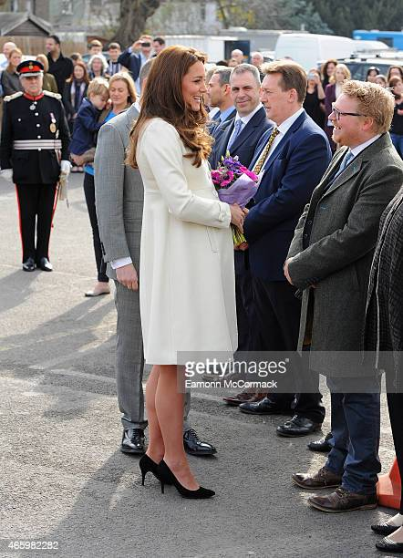 Catherine Duchess of Cambridge attends an official visit to the set of Downton Abbey at Ealing Studios on March 12 2015 in London England