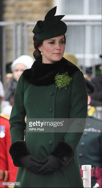 Catherine Duchess of Cambridge attends and presents the 1st Battalion Irish Guardsmen with shamrocks during the annual Irish Guards St Patrick's Day...