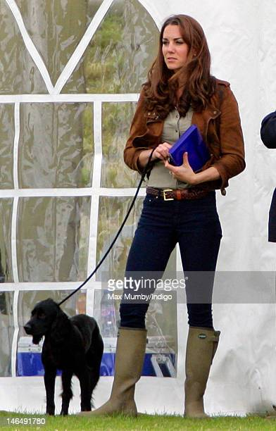 Catherine Duchess of Cambridge attends The Golden Metropolitan Polo Club Charity Cup polo match in which Prince William Duke of Cambridge and Prince...