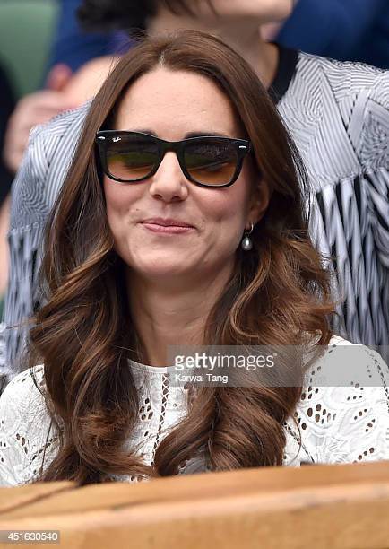 Catherine Duchess of Cambridge attends the Simone Halep v Sabine Lisicki match on centre court during day nine of the Wimbledon Championships at...