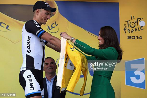 Catherine, Duchess of Cambridge awards the overall race leader's yellow jersey to Marcel Kittel of Germany and Team Giant-Shimano after he won stage...