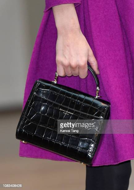 Catherine Duchess of Cambridge bag detail visits the Royal Opera House to learn more about their use of textiles commissioning of fabrics and supply...