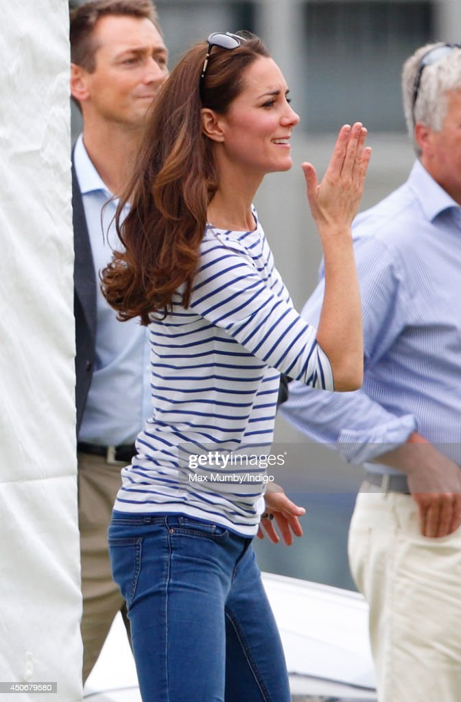 Catherine, Duchess of Cambridge blows a kiss whilst watching Prince William, Duke of Cambridge & Prince Harry play in the Jerudong Trophy charity polo match at Cirencester Park Polo Club on June 15, 2014 in Cirencester, England.