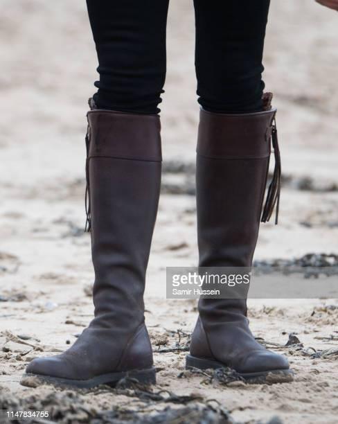 Catherine, Duchess of Cambridge, boot detail, visits Newborough Beach to join the Menai Bridge Scouts as they explore the beach's wildlife habitat...