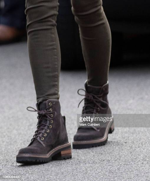 Catherine, Duchess of Cambridge, boot detail, visits the Islington Community Garden to see how the project brings people together through gardening...