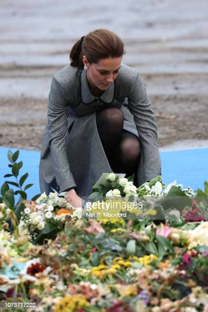 Catherine Duchess of Cambridge Cambridge lays a floral tribute to those who were tragically killed in the helicopter crash on Saturday 27th October...